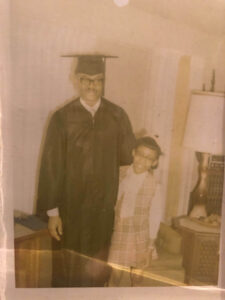 My father and me the day he received his bachelor's degree. I was in fourth grade